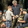 Scott Wright explain how to safely approach dinosaurs; photo by Susannah Wimberley
