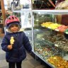 My daughter indulging in a chocolate lolly at Aigner Chocolates
