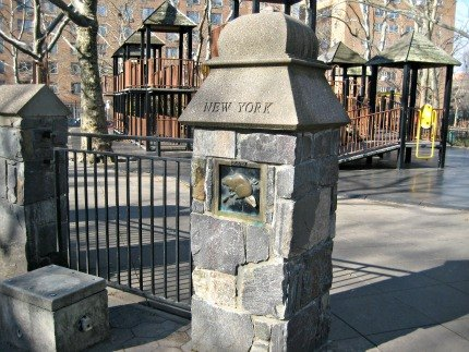 Pillars honoring each of the original 13 American colonies surround the<br /> St. Edwards Street playground