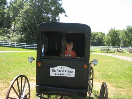 Mugging it up on a buggy at the Amish Village