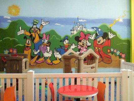 There's a dedicated toddler play area with a cheery Disney character mural