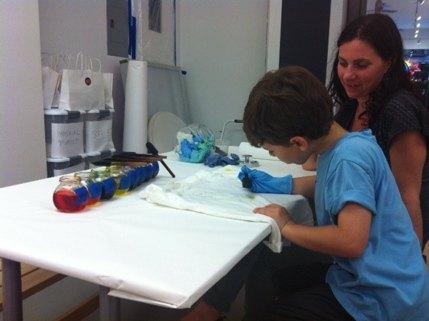 Fabric dye is applied using a sponge brush