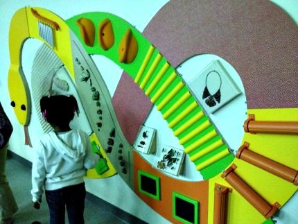 The sensory snake: an awesome tactile mural featuring real minerals and rocks that kids can touch