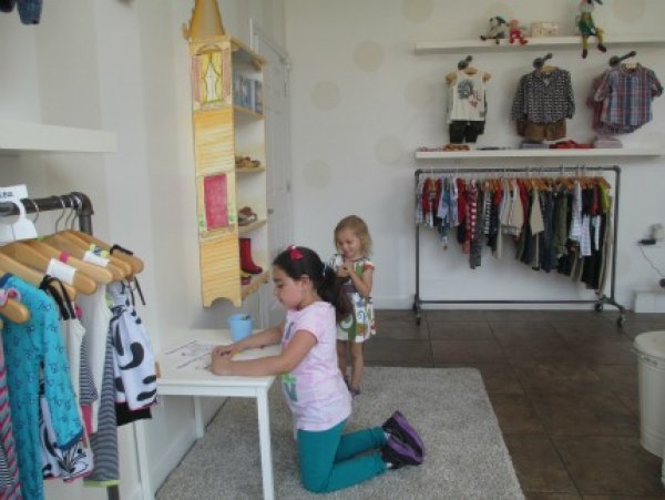 Kids are encouraged to color and play while parents shop