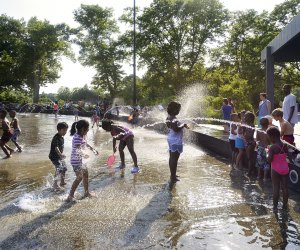 Cool off on a hot summer day at the expansive LeFrak Splash Pad in Prospect Park. Photo by Martin Seck for Prospect Park Alliance
