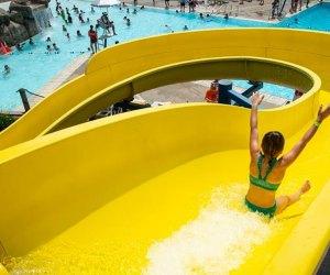 Best Outdoor Water Parks near Chicago: girl slides down water slide