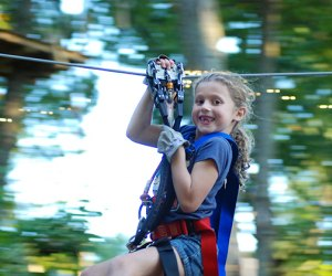 Girl smiles while zip lining at Camelback Mountain Adventures