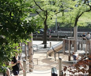 View of Ancient Playground through the foliage in Central Park