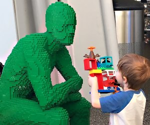 Green and blue brick men preside over the play stations at The Art of the Brick.