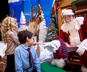 This year's visit to Santa requires a clear protective barrier. Photo courtesy of Bass Pro Shops