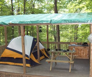 Tent set-up on raised platform Malouf's Mountain Sunset Campground