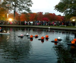 Jack-o'-lanterns alight on Belmont Lake during the Great Jack-o'-Lantern Spectacular Sail. Photo courtesy of Long Island State Parks and Recreation