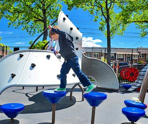 A top Queens playground, Paul Raimonda Playground offers sprinklers, climbing, and shady seating. Photo by author