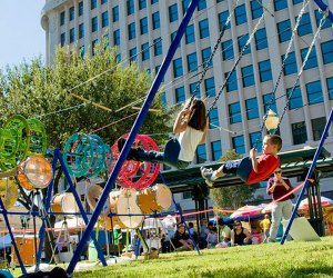 A seemingly simple swing makes a cacaphony of joyful music at Lincoln Center's Big Umbrella Outdoors Festival. Photo courtesy of the venue