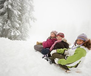 Sledding and smiles go hand in hand on Long Island. Photo via Bigstock