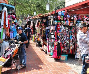 People bustle along Olvera Street