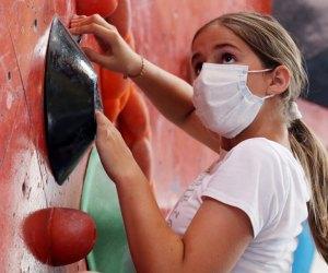 girl indoor rock climbing at Brooklyn Boulders Chicago winter activities for kids