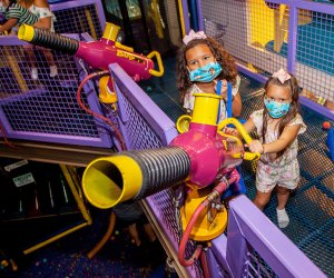 two girls shoot a bubble blaster
