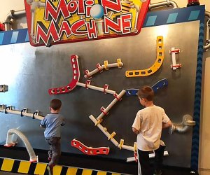 kids play on a motion machine musuem