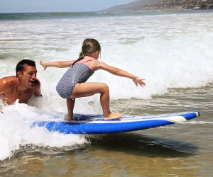 Traditional Outdoor Summer Camps for LA Kids: surf lessons camp summertime