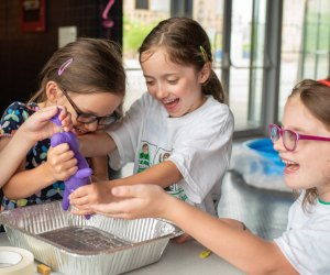 Collaborative problem solving is a hallmark of Camp Invention. Photo courtesy of Camp Invention