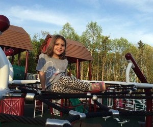 The farm-themed playground at Cedar Grove Park has a mini tractor, barn climbing structure, and more. Photo by Elaine Paoloni Quilici