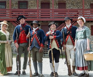 Historical interpreters pose outside The Old Barracks Museum.
