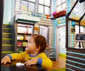 "City Owlets' fun-sized market and pizzeria let kids try out ""grown-up"" activities. Photo by Sydney Ng"