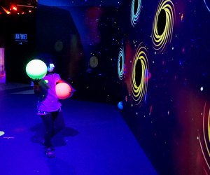 See how many black holes you can target with asteroids at Cosmic CAMP, a new intergalactic play space that's only here for a limited time.