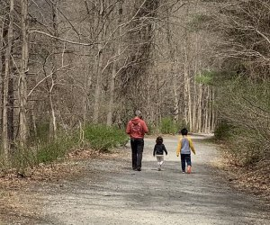 kids and dad hike along a trail in the woods at Croton Gorge Park