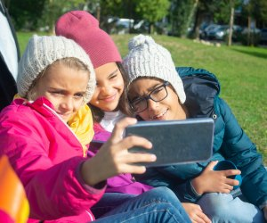 Selfies are fun, but make sure kids know how to be cell phone safe and smart. Photo courtesy of Kampus Productions, Pexels