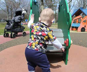 toddler plays at a playground