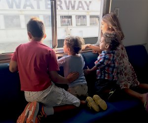 Kids take in the view from the Governors Island Ferry