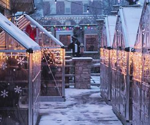 Winter villas and greenhouses keep families warm at Fiamme Pizza.