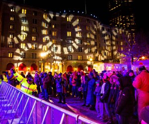 Copley Square is illuminated by a light show and pyrotechnics just before midnight. Photo courtesy of First Night Boston