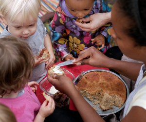 Kids gather around for snacks a the Broooklyn Forest nature preschool