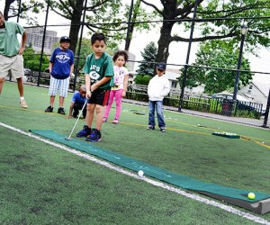 Children play golf with the City Parks Foundation