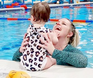 mom and baby at an indoor pool swimming class