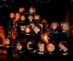 Detailed jack-o'-lanterns carved in celtic designs line the path at the Great Jack O'Lantern Blaze Long Island