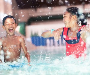 kids splashing in water park Great Wolf Lodge Where To Go Swimming in Chicago With Kids this Winter