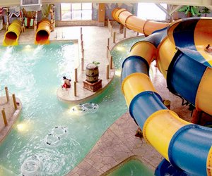 Great Wolf Lodge is filled with water slides your kids will adore, and the resort now offers day passes.