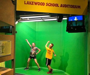 Jump on the greenscreen set and see yourself on TV
