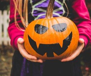 Pumpkin decorating is a Halloween highlight for kids