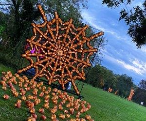 A giant spider web of jack-o'-lanterns greets visitors at The Great Jack O'Lantern Blaze on Long Island