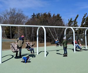 Kids of all abilities will delight in the Pickle Park swing area.