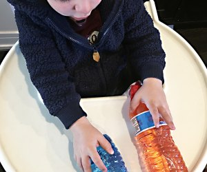 Turn a Highchair into a Baby Activity Center: A new way to recycle water bottles.