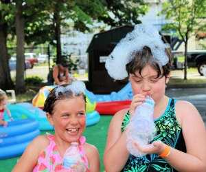 Splash and blow bubbles at the Outdoor Water Carnival. Photo courtesy of Imagine Nation