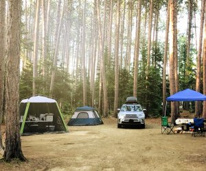 You'll be surrounded by woods at this Maine campground.