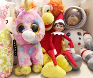 Elf on the Shelf hides among the stuffed animals