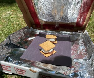 This solar oven science experiment offers one tasty reward: ooey, gooey s'mores.